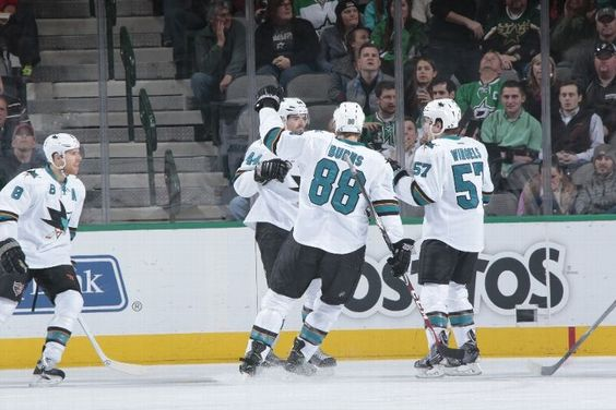 San Jose Sharks forwards Joe Pavelski, Tommy Wingels and defensemen Brent Burns and Marc-Edouard Vlasic celebrate Vlasic's first period goal (Feb. 19, 2015).