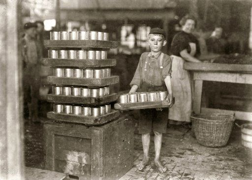 "July 1909. Baltimore, Md. ""One of the small boys in J.S. Farrand Packing Co. and a heavy load. J.W. Magruder, witness."" Photo: Lewis Wickes Hine:"
