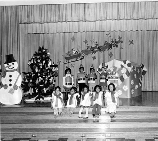 Herrick Avenue School Holiday Program, December 1978. First-graders pictured, front row (l-r) Javy Castanon, Robert Montand, Lori Dominguez, Claudia Ponce, Estella Argote. Back row (l-r): Veronica Garcia, John Chavez, Richard Kim, Carla Bowman. Robert and Betty Franklin Collection. San Fernando Valley History Digital Library.