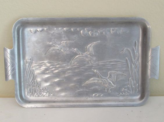 This a great industrial office piece - Small Vintage Aluminum Tray embossed with ducks for use on a desk or as a small wall hanging.  Etsy  MaryAndGeneva, $4.00