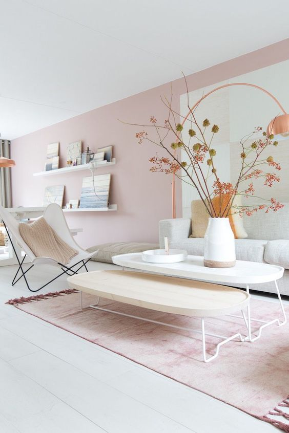 Powder Pink Walls and Copper accessories this living space looks lovely and relaxing. Probably one for the girls.