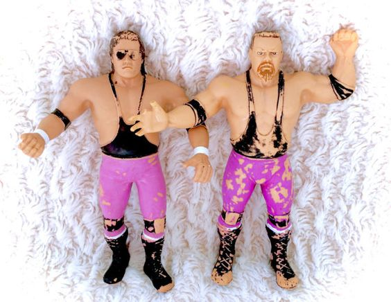 A super rare vintage 1987 LJN HART FOUNDATION tag team set! Bret Hart & Jim Neidhart. They do have some visible paint rubs and one has some digits missing. Please see pictures up close for thorough representation of what to expect!  I have TONS more fantastic vintage items like this in my Etsy store -check it out for cheap combined shipping!  I ship WORLDWIDE from a clean, pet & smoke-free home! Please note that shipping times will be slower OUTSIDE of the US & Canada (up to 3 months), and…
