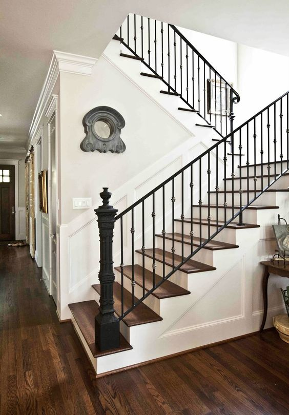 French White Living Room...Cedar Hill Ranch staircase.  Rod iron fence post used