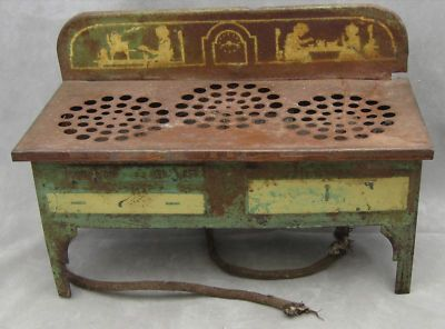 http://www.antiquesnavigator.com/d-526633/curious-antique-toy-stove-3-electric-burners-not-wkg.html