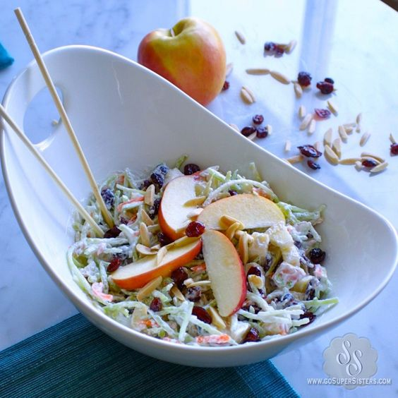 Cran-Apple Fruit Salad Makes 4 servings  2.5 cups of broccoli slaw*  1.5 cups non-fat greek yogurt 1 apple, chopped 1/3 cup of dried cranberries 1/4 cup sliced almonds 1 tsp cinnamon 1/2 tsp vanilla extract stevia to taste Calories: 160 Fat: 4 g Carbs: 21