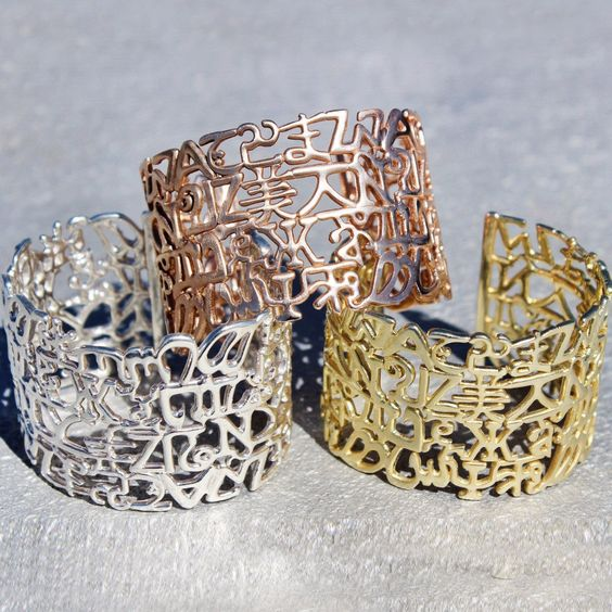 UNITE Collection Alphabet Grande Cuffs // Rose Tone, Gold Brass & Sterling Silver cuff style bracelets // Beautiful statement bracelets supporting a message of unity and acceptance across the world // Shop today https://www.exohdesigns.com/collections/unite-collection/products/unite-alphabet-grande-cuff-brass?variant=11510023809