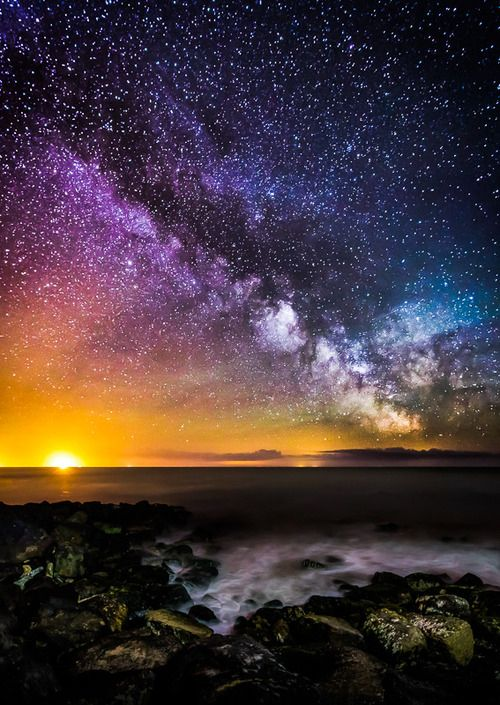 Starry sky colorful clouds sun ocean water stars night ...