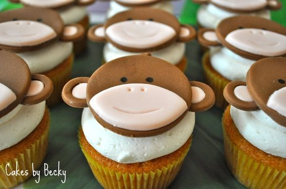 Vanilla cupcakes with vanilla buttercream icing and hand made fondant/gum paste monkey toppers for a Jungle themed baby shower :)