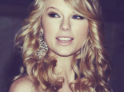 Taylor Swift.  You're the only other person I know that likes her as much as I do.  :)