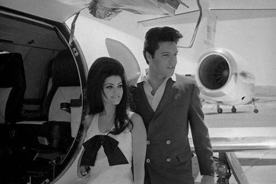 Elvis Presley posing with wife Priscilla.
