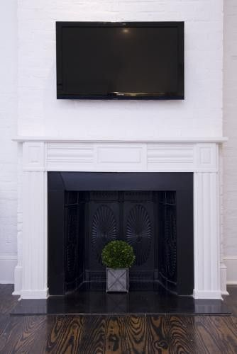 White Painted Brick Fireplace With Black Insert Hotel Royal Nola European Farmhouse