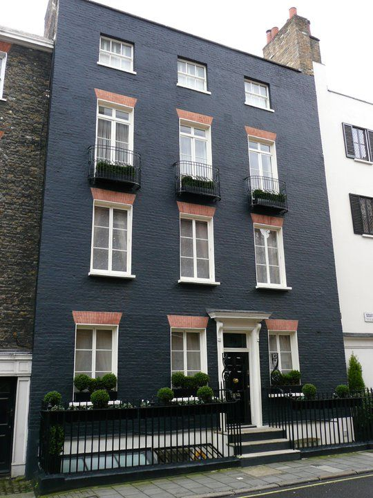 Dark gray painted brick pinteres for Brick facade house