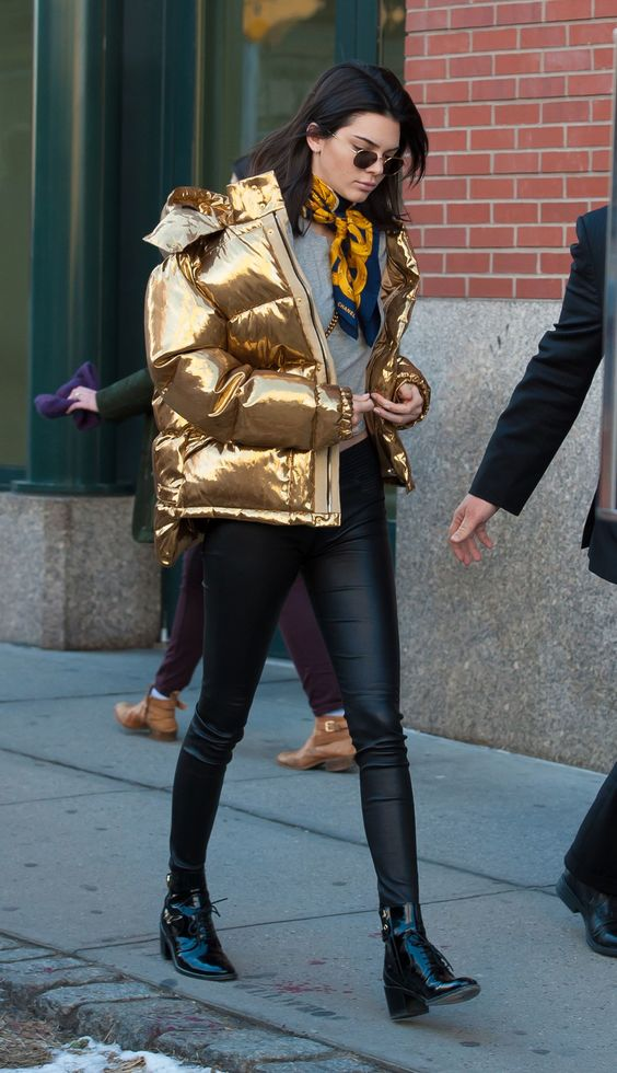 Kendall Jenner ups the traditional puffer jacket ante with a metallic punch.
