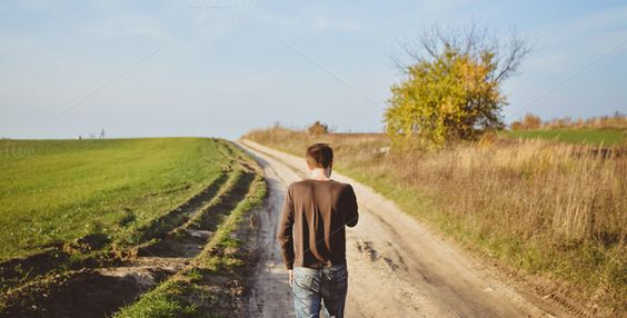 Back view of Man Walking on Ground by roman.trofimiuk on Creative Market