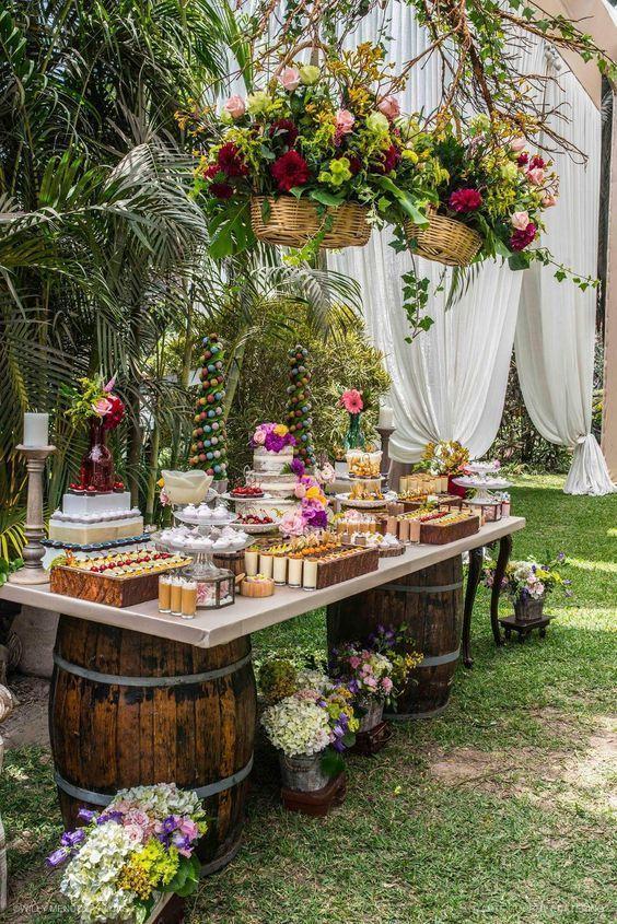 27 Rustic Wedding Decorations You Must Have A Look Wooden Barrel Wedding Food Bar Hangi Rustic Wedding Decor Romantic Outdoor Wedding Engagement Decorations