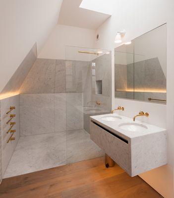 Paddington House. Maybe bit stark? But double basin with gold wall volas
