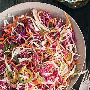 This citrusy take on coleslaw is fresh and pleasantly spicy, an ideal side dish or burger or brat topping. Leave the seeds in more peppers for added fire, or seed all of them for a milder dish.