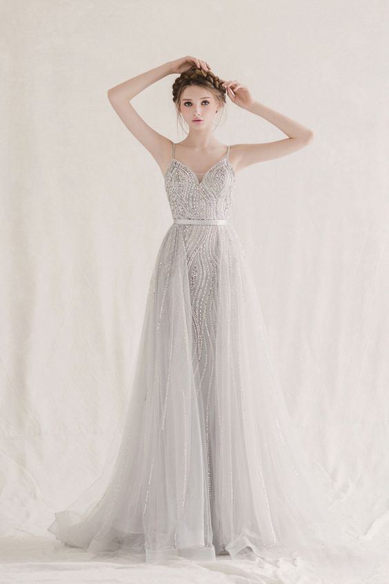 Whimsical, unique, and magical, this glittering silver gown from Bonna & Kimvelo is downright droolworthy!