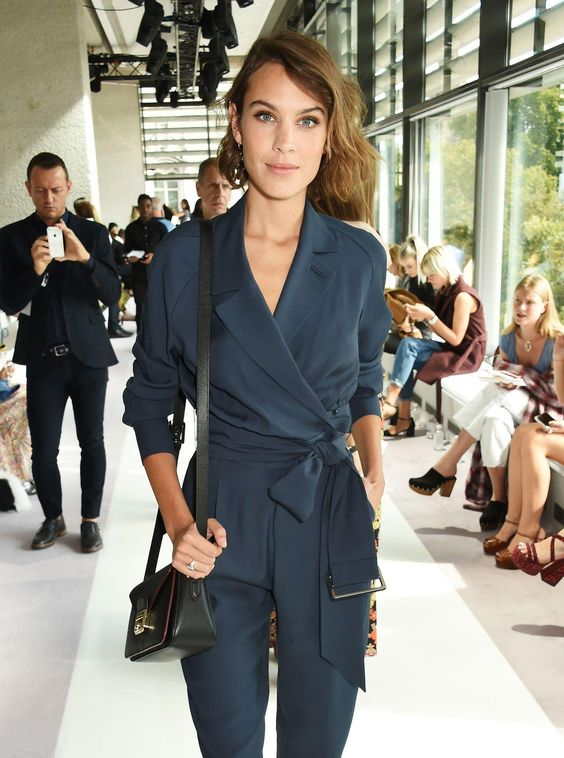 Alexa Chung wears a silk blue tied jumpsuit to Topshop Unique: