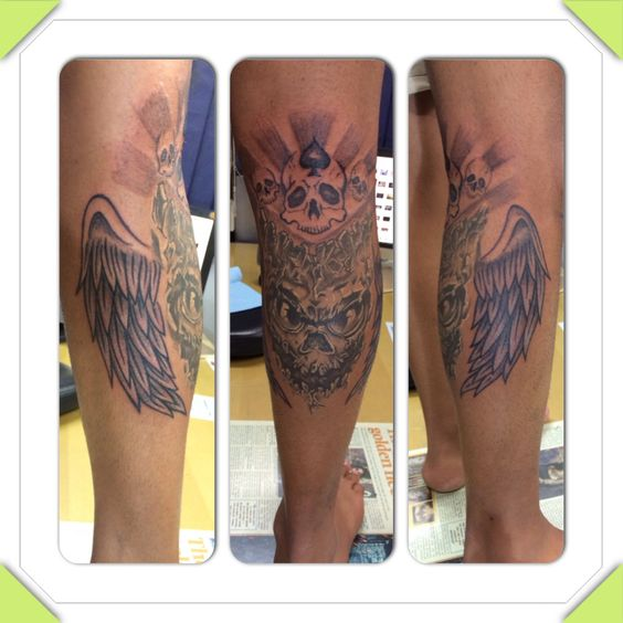Leg tatoo ... The demon , with wings of fairy (sign of independence) ,satan skulls,and moury on the lower end tribal design