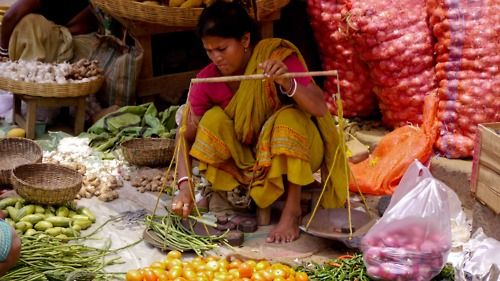 On location with HALF THE SKY: A woman selling wares in India (Courtesy Joshua Bennett)
