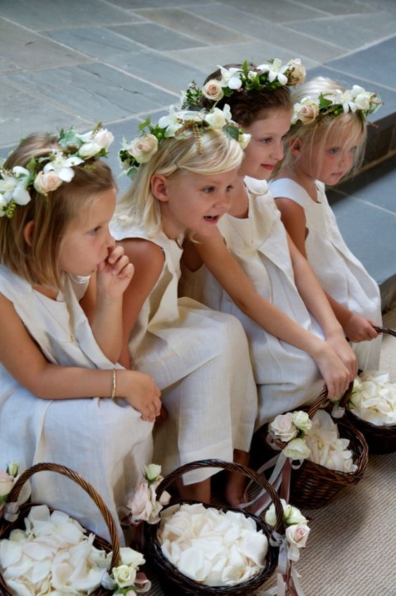 Simple rustic baskets with or without attached flower posies/ribbon, filled with fresh petals or confetti
