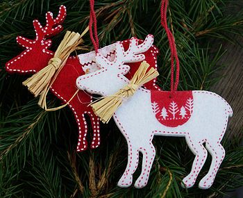 red and white reindeer felt ornaments;  use a cookie cutter for the shapes, then use a contrasting colour to stitch the edging.