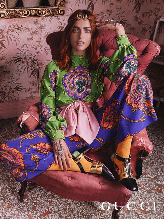 Roman Rhapsody: the Gucci Cruise 2018 campaign lensed by Mick Rock features actress Miriam Leone in printed silk pants and shirt, hand jewelry with crystal lyre details, GG knitted socks and T-strap pumps.