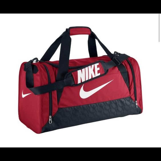 NIKE MEDIUM DUFFEL BAG The main picture is a SIMILAR, look to the bag I'm selling, the one I am selling is an older version but brand new, tickets and all never used . Please be conscience of bid prices .. Poshmark does take a percentage so please be reasonable when submitting a bid . Thanks :) Nike Bags Travel Bags