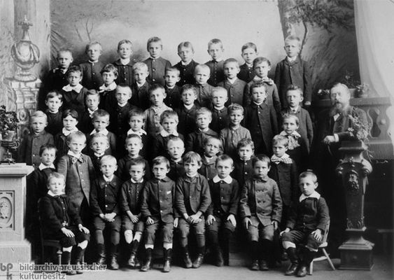 Fifth-Grade Class in the Middle School in Wittenberge (1888)  This photograph was taken in the studio of A.C. Mohns.