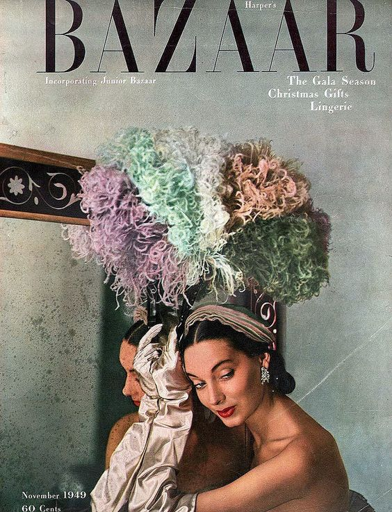 Betty Threatt in layered tulle cap and tortoise-shell fan with multi-colored ostrich feathers and gloves all by John Frederics, cover by Louise Dahl-Wolfe, November 1949