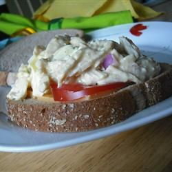 Chunky, eggy, chicken (Cheggy) salad makes a perfect summer sandwich. Pine nuts, Parmesan cheese, and pickle relish add extra flavor and crunch.