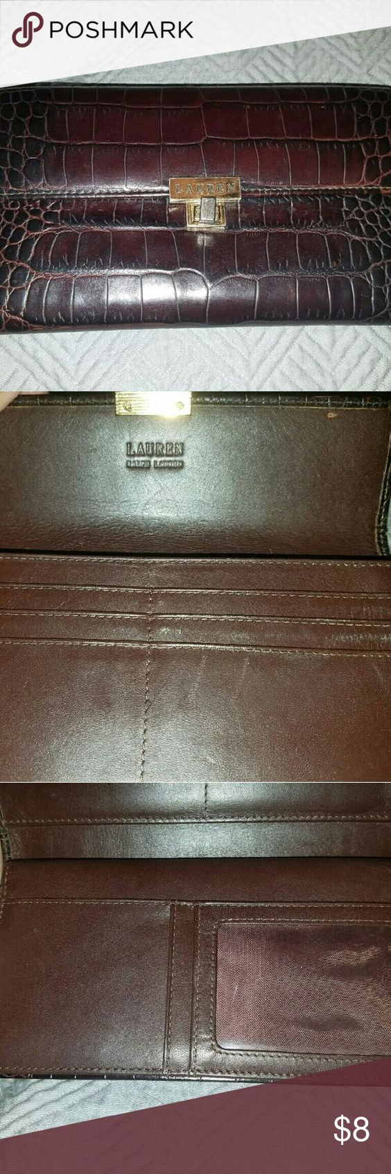 Ralph Lauren wallet Dark brown leather wallet, wear and tear depicted in photos. Has a zippered pocket inside as well as removable part for a check book.  There is a also a pocket on the back. Ralph Lauren Bags Wallets