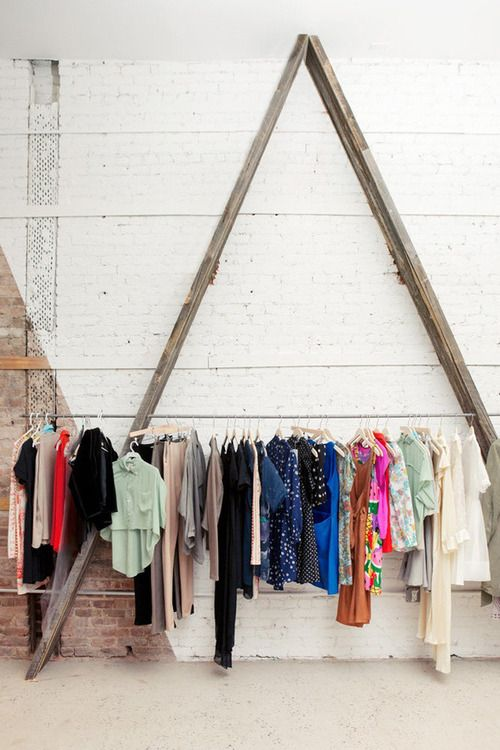 hanging clothes artistically. wooden ladder.