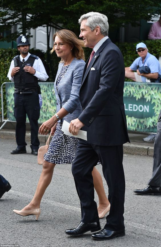 The Duchess of Cambridge's mother Carole Middleton, 61, looked chic in a white and navy spotted dress that wouldn't look out of place on her daughter Kate as she arrived at Wimbledon today with husband Michael