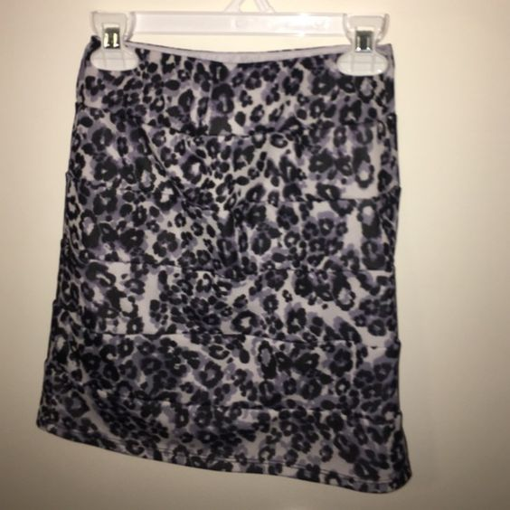 Blue & Purple Animal Print Skirt Cheetah/Leopard print mini skirt. Very lightly worn, in condition same as bought. Worn 2 times. Navy blue white and purple print. Stretchy material. Iz Byer Skirts Mini