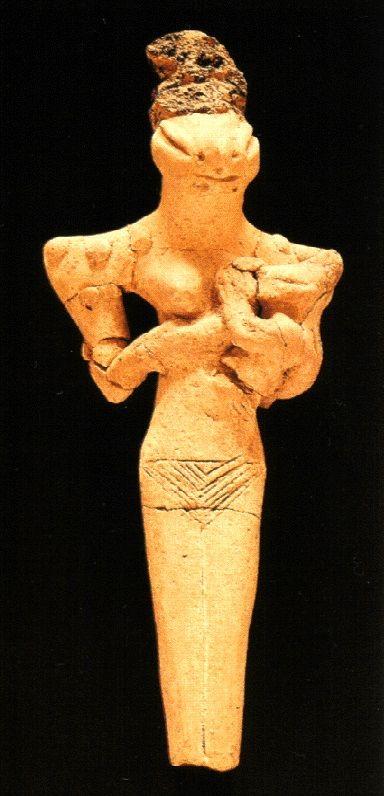 Divindade feminina com cabeça de ofídio e criança nos braços, IV milênio a.C., Museu do Iraque, Bagdá.