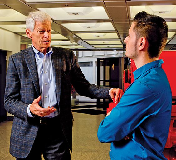 Mark Levett, chief executive officer of the Cummins Foundation, talks with budding engineer Uriel Lopez. Lopez, a graduate of the Columbus Signature Academy, is now enrolled in the Purdue Tech Mechanical Engineering Technology program and also works full time as an apprentice draftsman at Cummins Inc.