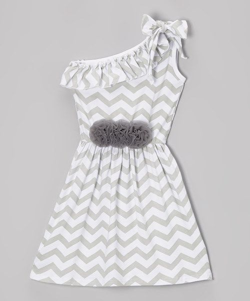 This sweet and breezy dress is perfect for a picnic in the park or a day on a boat! A one-shoulder style not only means this frock is hip but also keeps it airy and light for warmer days outside. A soft and stretchy cotton blend ensures little ladies stay comfy.