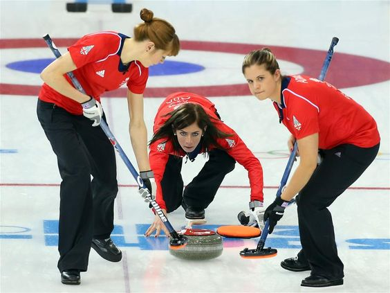 Claire Hamilton and Vicki Adams of Great Britain sweep the ice as Eve Muirhead delivers the stone during the Curling Women's Round Robin match between Japan and Great Britain on day 8