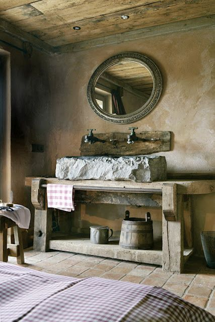 Gorgeous rustic bathroom with a perfect mottled, natural looking textured plaster wall treatment.