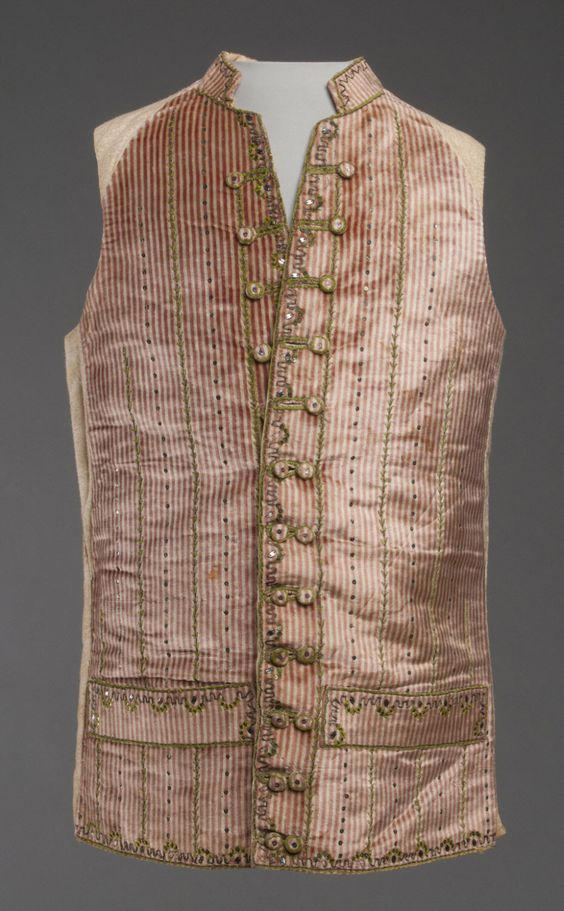 Waistcoat, France, 1785-1790. Cream and red striped silk velvet with silk chenille embroidered couching, silver thread, and silver sequins: white cotton flannel lining.