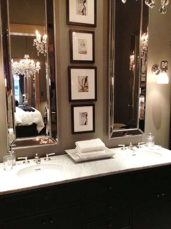 Love the tall mirrors with the photos in between. So very glamorous! Guest bath