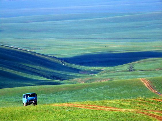 Mongolia prairies-the road less traveled in old Russian made vans.  Fond memories.