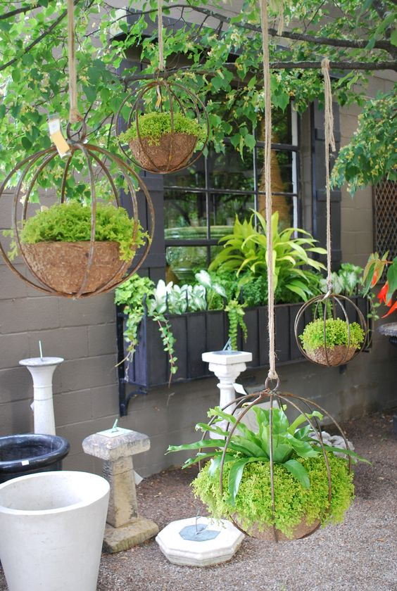 hanging gardens- I love these repurposed iron spheres as plant hangers and…