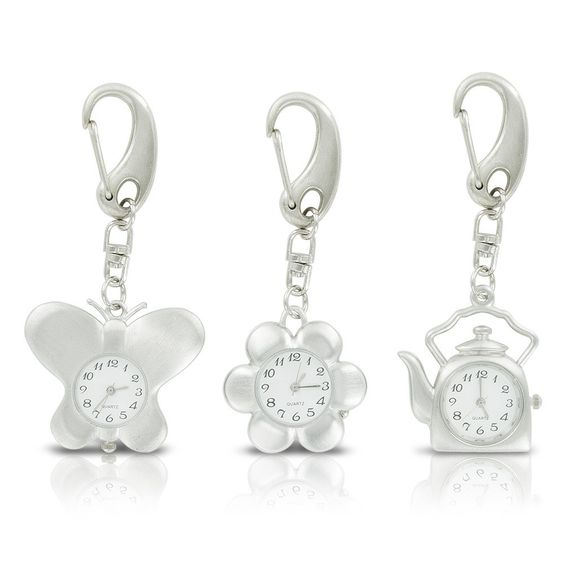 Novelty Key Chain Watches 3-Pack Always have the time whenever you need it with this set of Novelty Key Chain Watches. This 3-pack includes one flower key chain, one butterfly key chain, and one tea kettle key chain. Each watch features a white face with black numbers for easy visibility, quartz movement, and a stainless steel back. The clip makes these ideal for attaching to car keys, backpacks, purses, and more. And with three different key chains included, you can keep one for yourself…