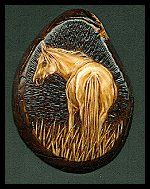'White Horse' - I really have to work on my titles;) Pyrography on a tagua slice. Sold.