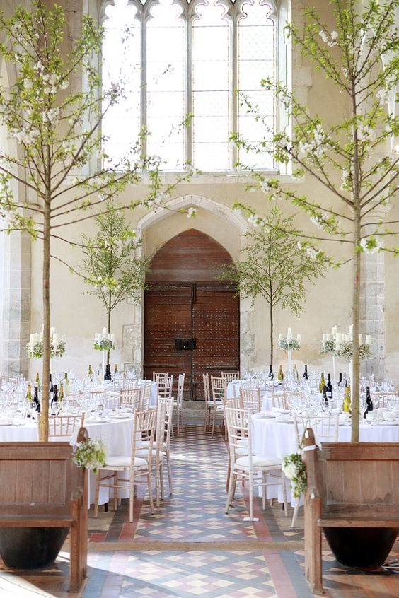 White wedding reception in a church #churchreception #realtrees Photography: Dasha Caffrey Location:  All Saints' Church in Boughton Aluph, Kent