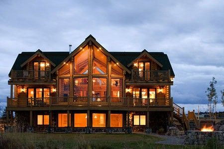 My dream home!! Log cabin with tons of windows and a big front porch.