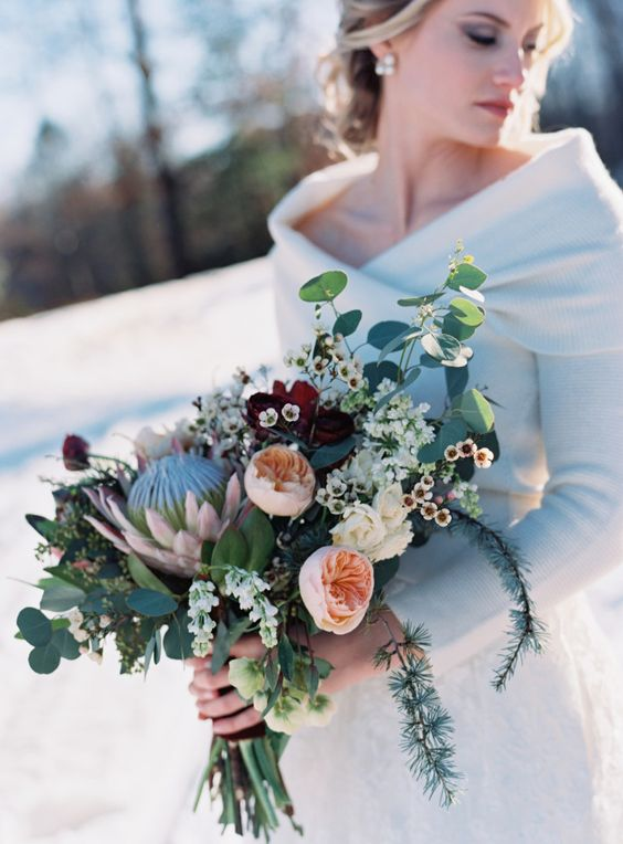 Wintery protea bouquet: http://www.stylemepretty.com/little-black-book-blog/2016/04/07/cranberry-copper-winter-wedding-inspiration-cute-pup-included/   Photography: Charlotte Jenks Lewis - http://charlottejenkslewis.com/